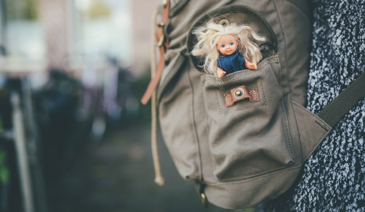 A doll in a backpack