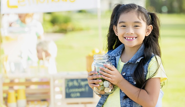 Little girl selling lemonade