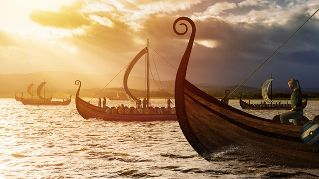 Picture of a viking ship sailing in sunset