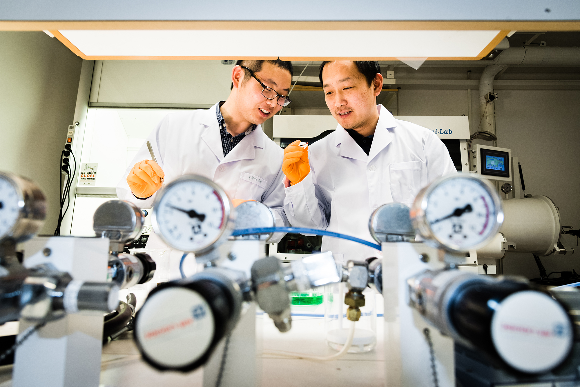 Weihua Ning (Left) and Feng Gao (right) are discussing their lead-free devices.