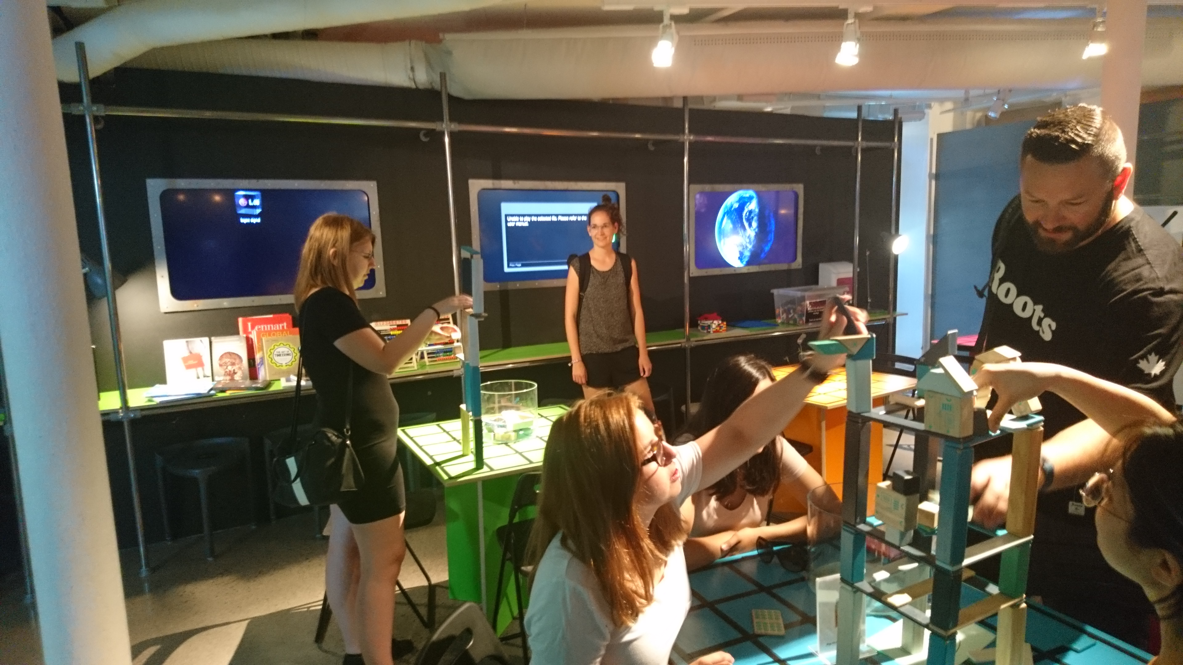 The students get their hands on the interactive exhibitions at Visualization Center C.