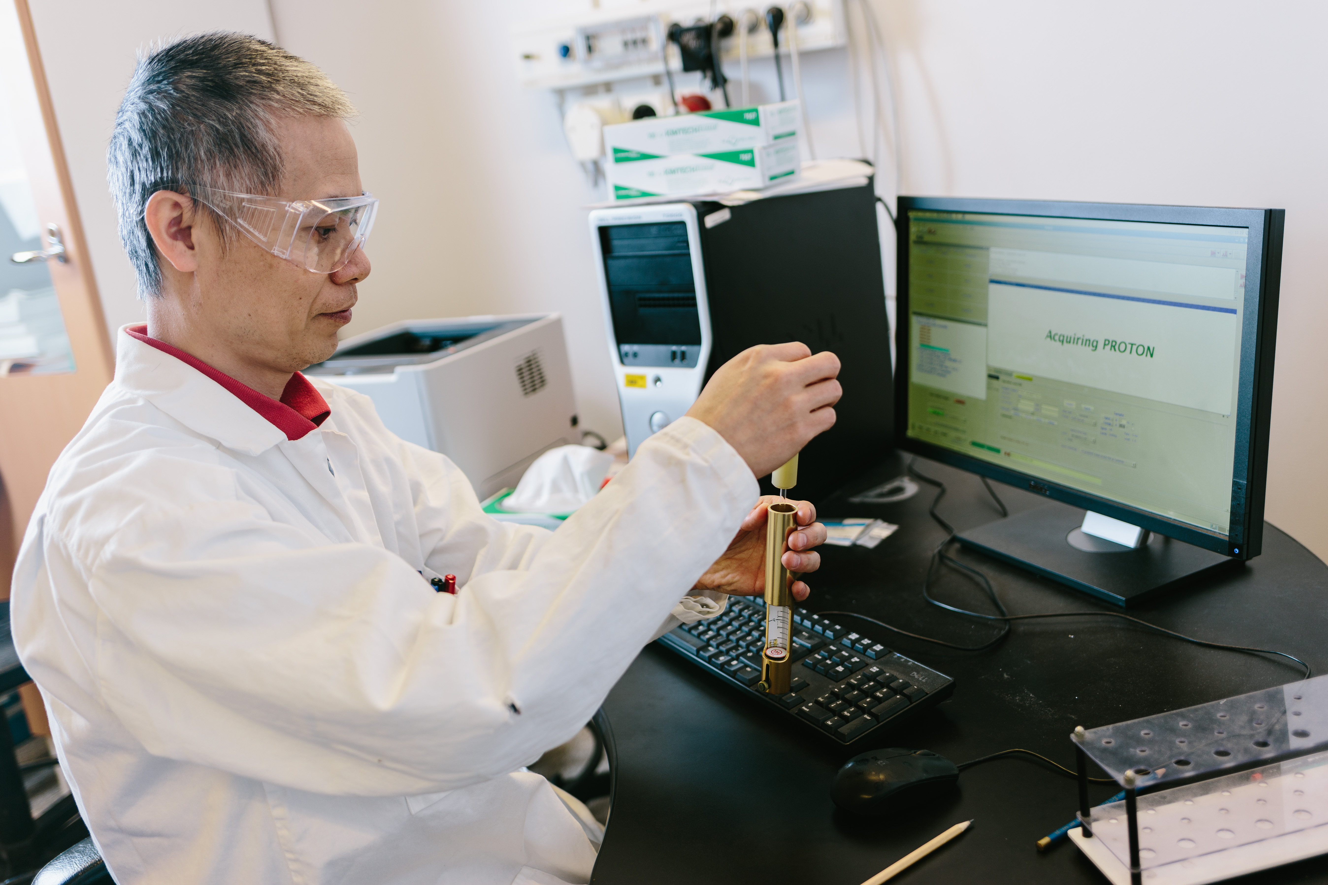 researcher analysing sample