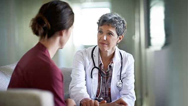 A doctor talks with a patient.