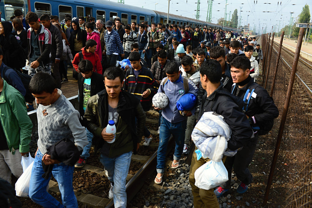 Hegyeshalom, Hungary - October 6, 2015:  Group of refugees leaving Hungary. They came to Hegyeshalom by train and then they leaving Hungary and go to Austria and then to Germany. Many of them escapes from home because of civil war.
