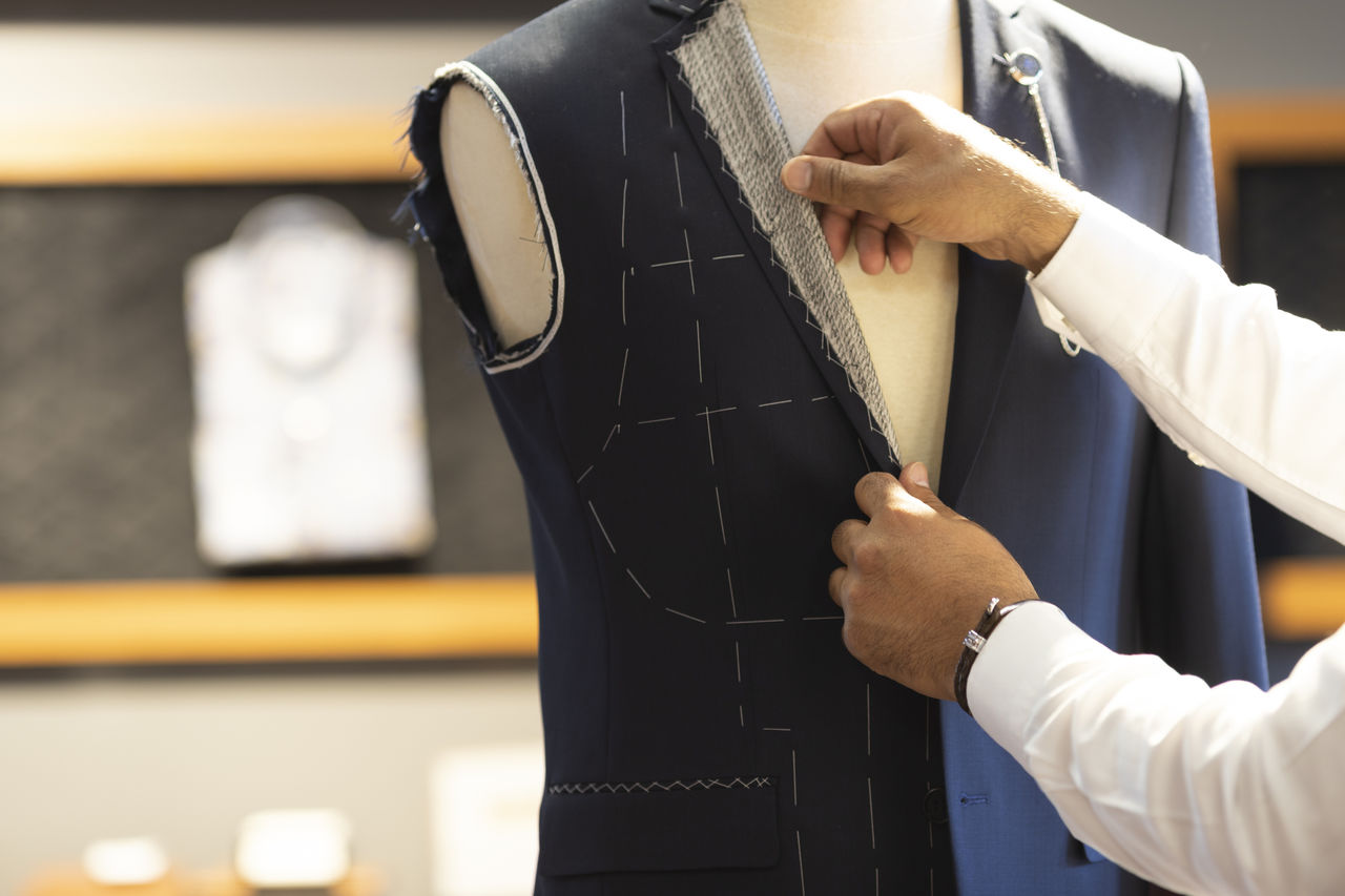 Man Measuring Jacket on Male Dress Form