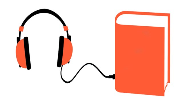 A book that is connected to a pair of headphones with a cord.
