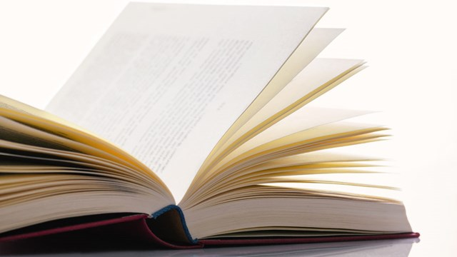 Close-up of book pages in an open book.
