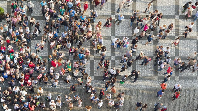 Large group of people on a market square. Photo taken from above.m.