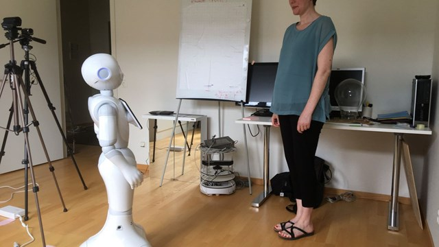 Katherine Harrison and a robot