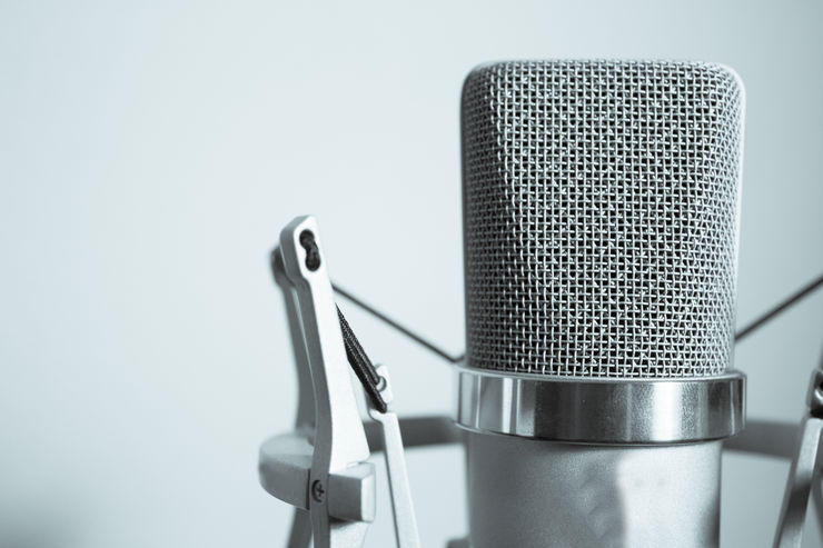 Professional microphone silver on white background