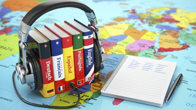 Language books and map.