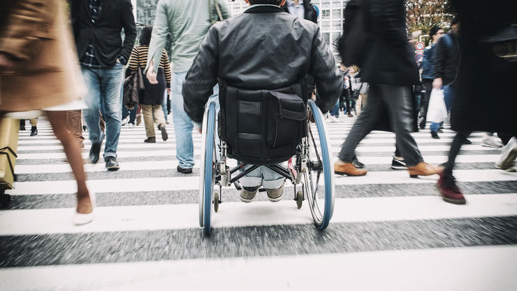 A Japanese man in a wheelchair in the Shibuya Ward of Tokyo, Japan.