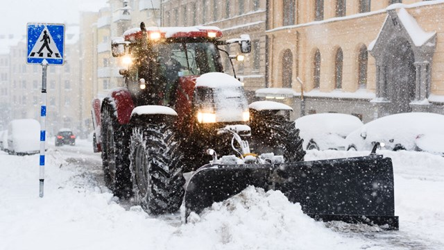 Stockholm, Sweden - November 9, 2016:Plow removing snow from city street in Stockholm. Motion blur visualizes the speed and dynamics.