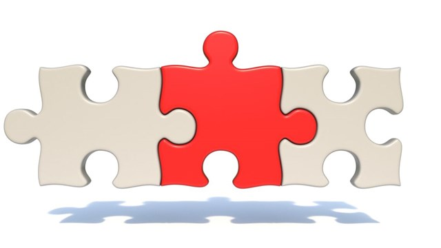 Three puzzle pieces that fit together.