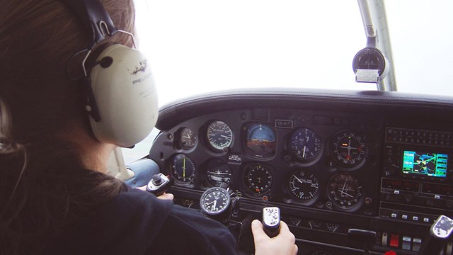 Pilot controls the plane in the cockpit.