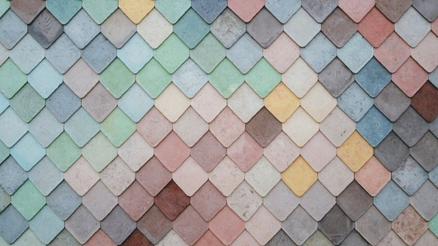 Square small wall tiles in different colors and shades.