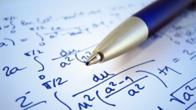 Blue pen lying on a paper with mathematical text.