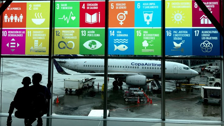 An airport with the UN sustainability goals at the widow