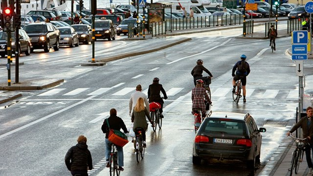 People on bicycles at Skeppsbron in Stockholm.