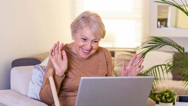 Elderly woman in front of computer.